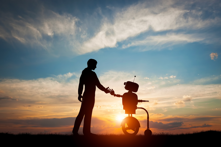 Man and robot shake hands with sunset in background, symbolizing cooperation and harmony