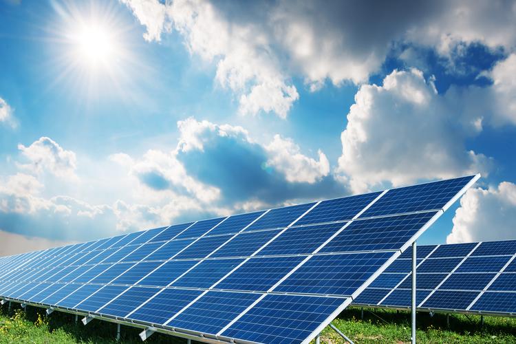 Solar panels reflecting blue sunny sky