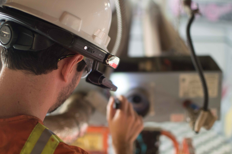 Worker using hands-free augmented reality (AR) device