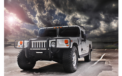 HUMMER vehicle parked with cloudy sky background