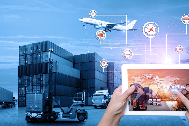 Worker using tablet to make use of supply chain 4.0 technologies and tools, with shipping dock in background
