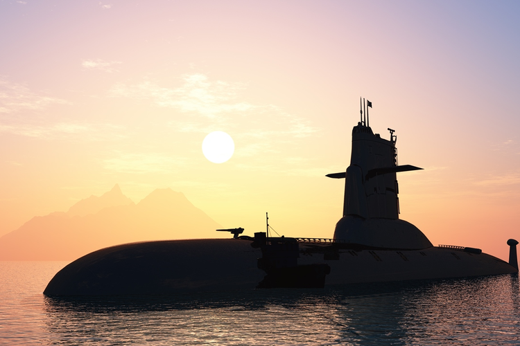 Submarine partly submerged with sunset in background