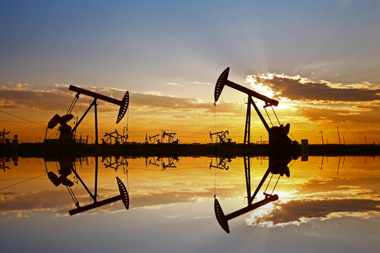 Crude oil pumps with sunset in background