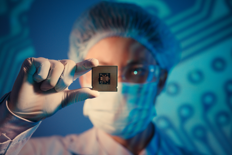 Computer engineer holding a microchip