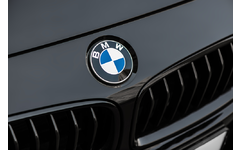BMW logo on the front portion of a black car