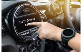 Finger Pushing Self-Driving Mode Button on Car's Dashboard.