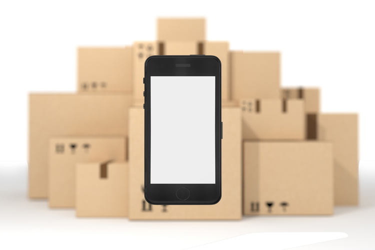 Smart phone in front of boxes