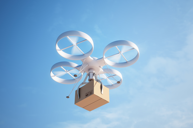 Drone flying holding a delivery box