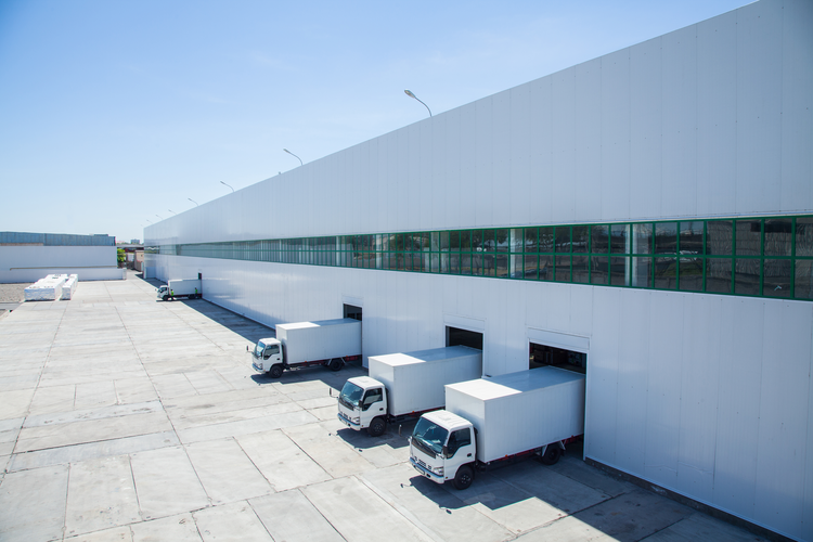 Trucks Loading at a Warehouse