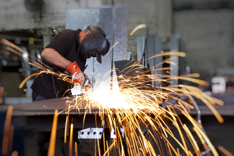 Sparks flying over the work table during metal grinding.