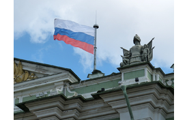 Russian flag flying on a flagpole on top of a building