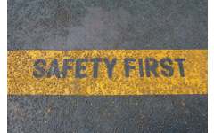 Safety first sign on industrial caution strip