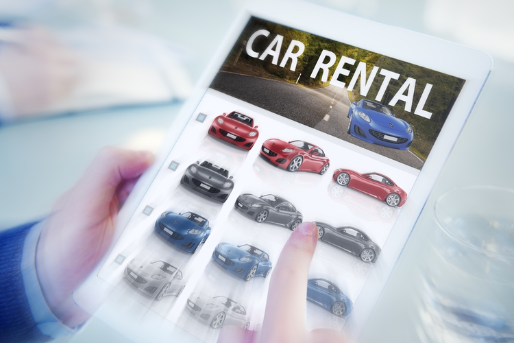 Car rental selection shown on a tablet.