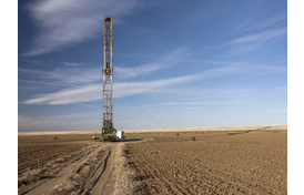 Fracking rig in dirt field