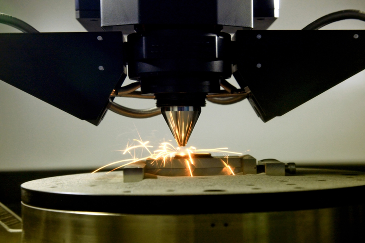 Head of 3d printer printing a metal piece.