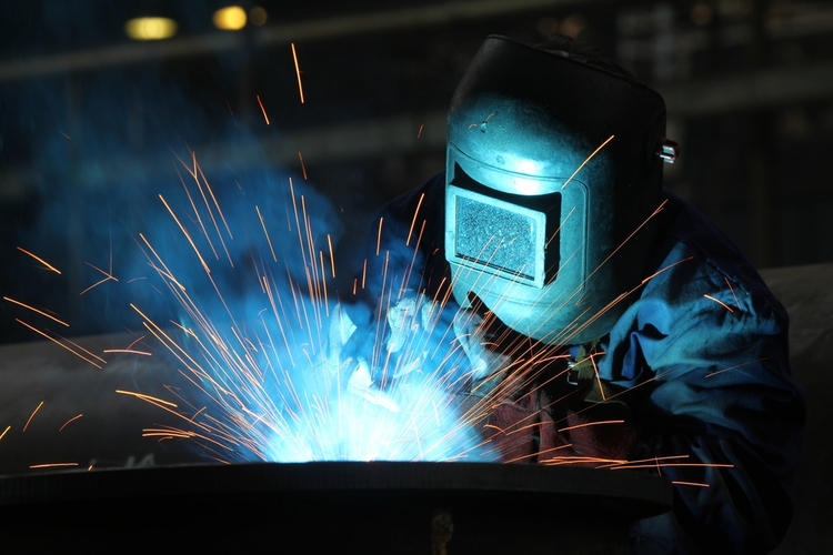 Welder with protective mask.