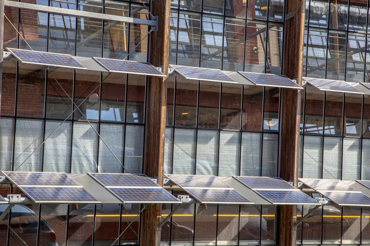 Solar panels on the front of an office building.