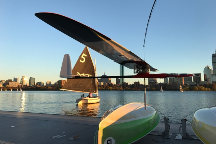 An albatross glider, designed by MIT engineers, skims the Charles River.