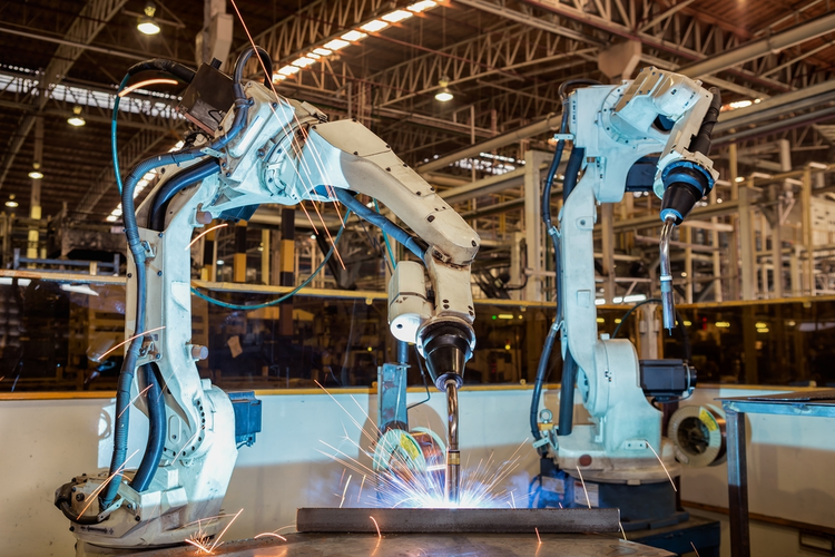Industrial robots welding in an automotive factory.