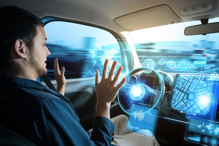 Man riding in autonomous car.
