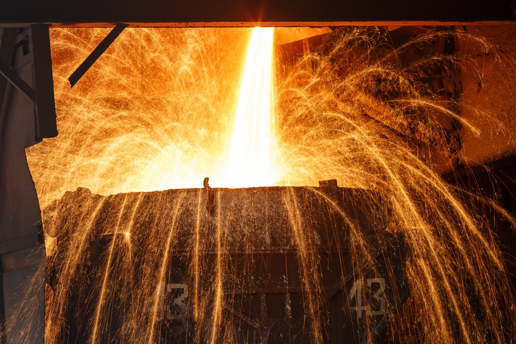 Blast furnace smelting liquid steel in steel mill.