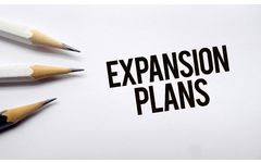 Expansion Plans Memo With Pencils