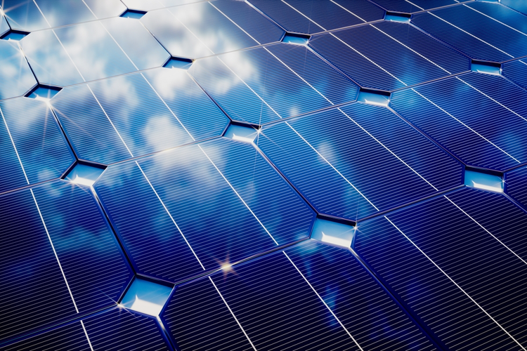 Solar panels with cloudy reflection.