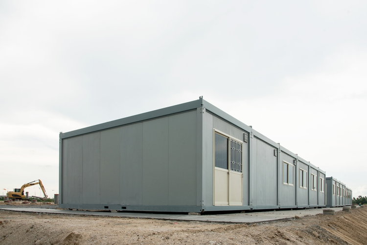 Modular building on industrial site.