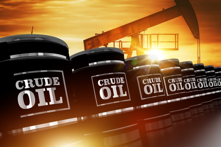 Crude oil trading concept with black crude oil barrels and oil pump during sunset.
