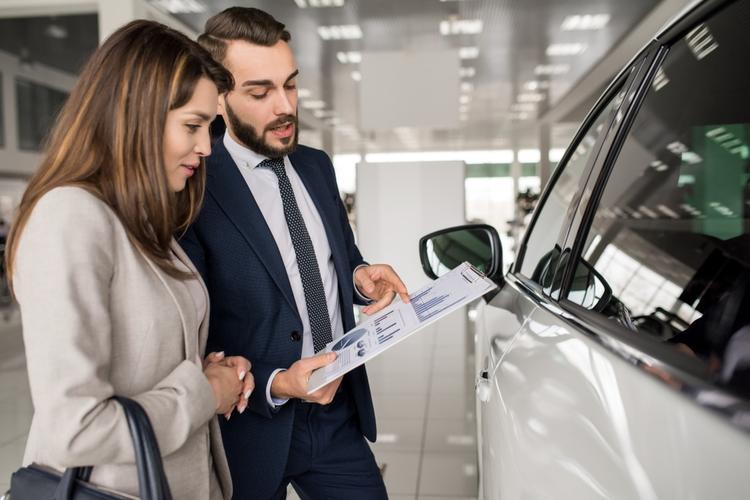 Car salesman talking to customer.